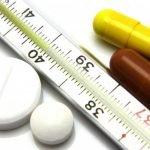 градусник и таблетки